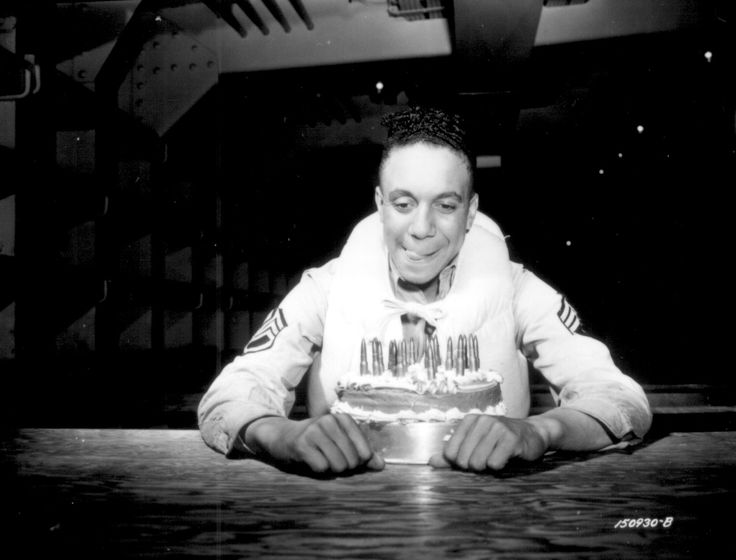 African-American US Army sergeant celebrating his 19th birthday, May 1942