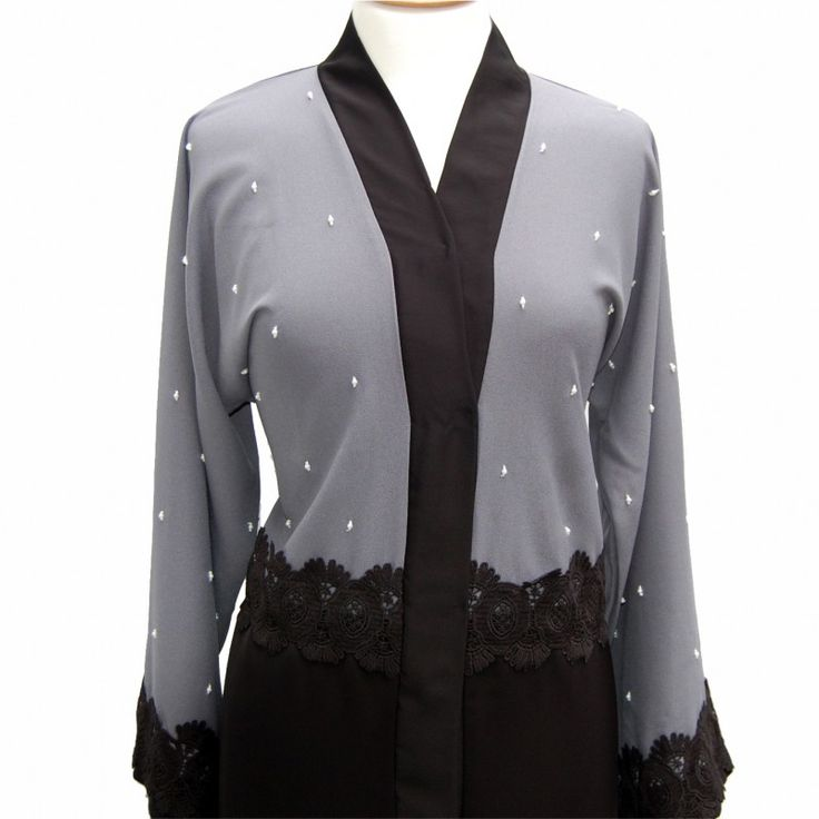 This elegant half grey and black Nida abaya carefully hand stitched with gorgeous pearls. Popper buttons along the front. Comes with a matching scarf.