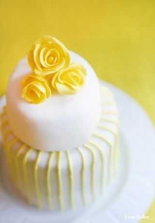 Yellow wedding cake by Juca