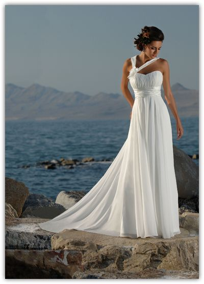 Get beach wedding dress inspiration by clicking the image!