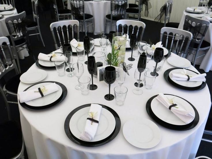 Black and white table setting for daughter's wedding.