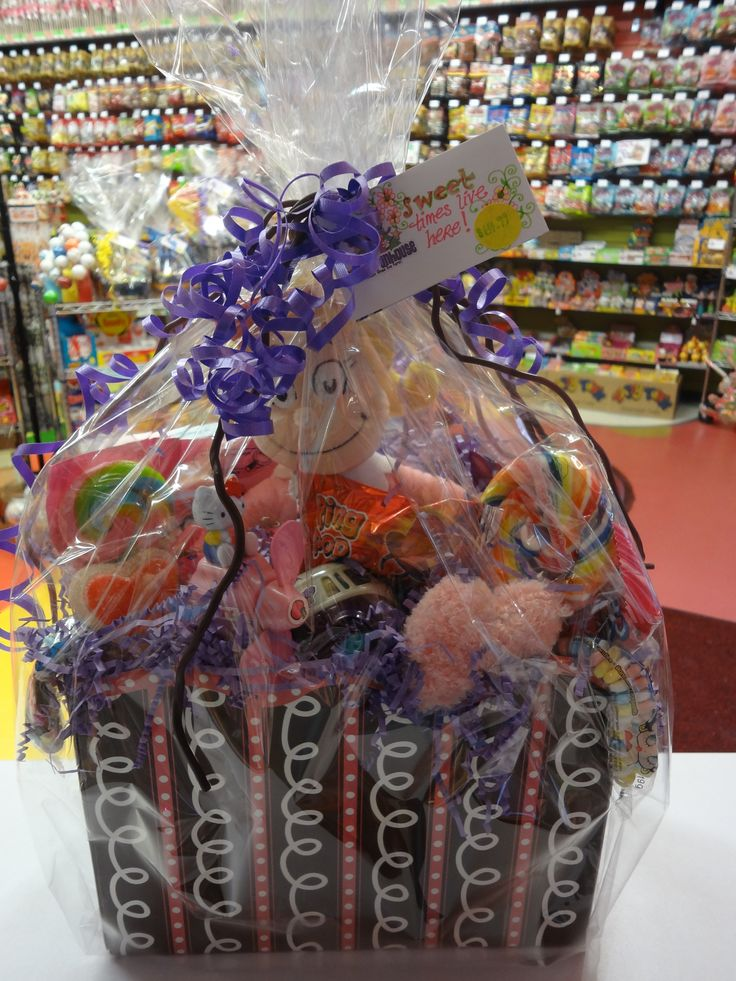 """""""Sweet Times Live Here"""" A fun girly basket, featuring a Cindy Lou Who doll, lots of lovely lollipops, and a Hello Kitty toy with candy!"""