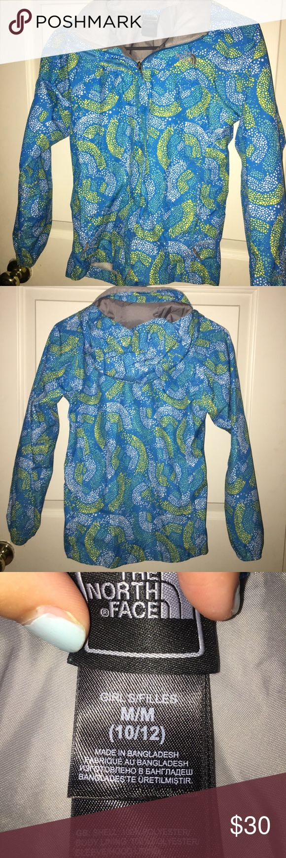 Girls north face rain jacket Blue, yellow, and white girls rain jacket size medium. Barely worn and great condition! North Face Jackets & Coats Raincoats