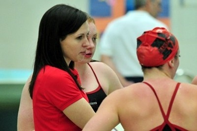 Mansfield University head women's swimming coach Kaymee Kelly turned in a pair of top 10 finishes at the recent 2013 U.S. Masters Swimming (USMS) Spring National Championship at the IUPUI Natatorium in Indianapolis.