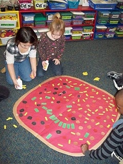 """What fun to make a gigantic pizza - could do this by picking an """"ingredient card"""" and then rolling the dice to put that many pieces on the pizza"""