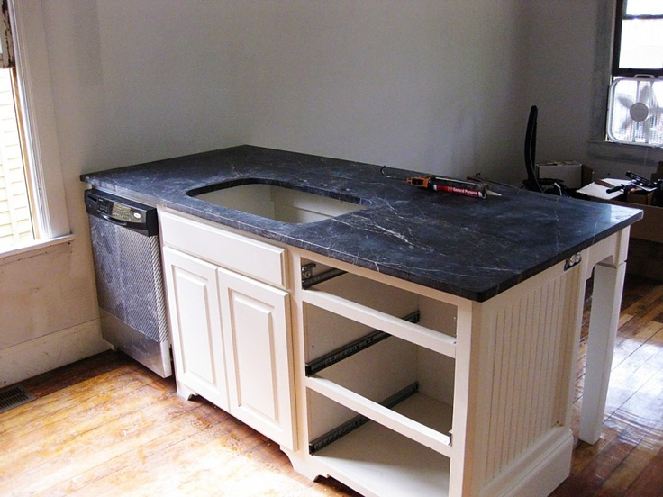 Counter height peninsula with dishwasher, sink, and