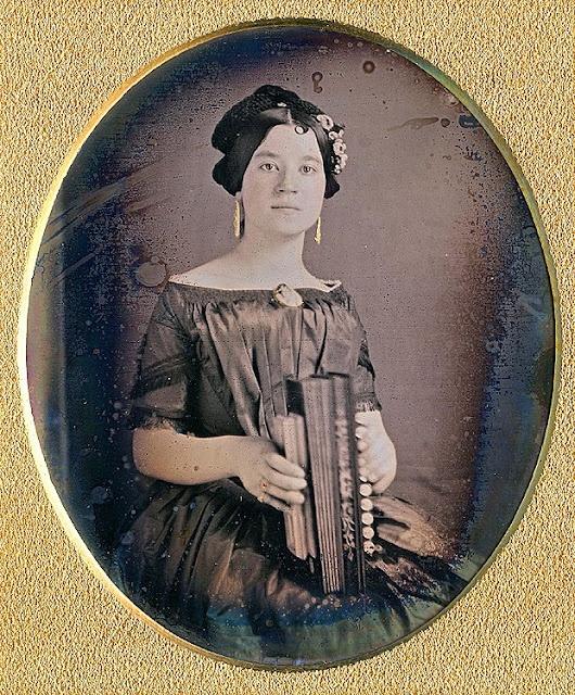 Woman with concertina (accordion). Mid 19th century daguerreotype.