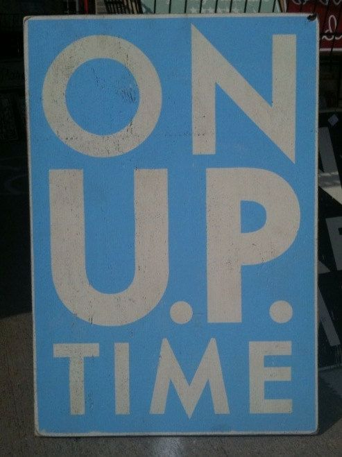 "ON ""UP"" time. Rustic sign for Michigan's upper peninsula"