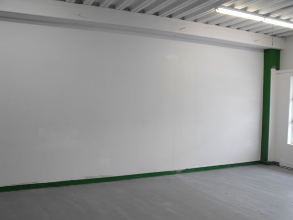 North wall, the remainder of the wall not opened up to the current space will become the location for our many paint racks.