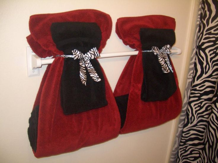 Fancy Bathroom Towel Display with Red and Black Colours