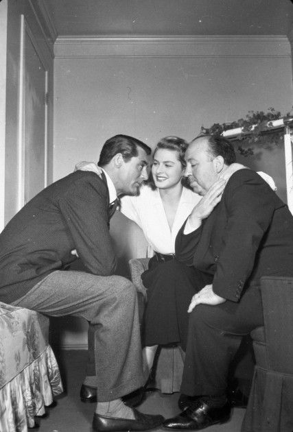 """Cary Grant, Ingrid Bergman and Alfred Hitchcock on the set of """"Notorious"""" (1946)"""