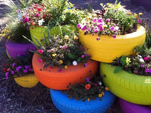 brightly painted, stacked used tires, upcycled as planter