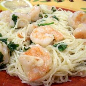 Shrimp portofino - this is the best recipe I've found so far. I suggest using only 1/4 cup lemon juice. Also, don't mix in the pine nuts as suggested. Toast and add upon serving.