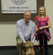 Medina fourth-grader Grace Nelson and her dog, Charlie, were the winners in this year's Top Dog essay contest sponsored by the Medina County Auditor's Office.