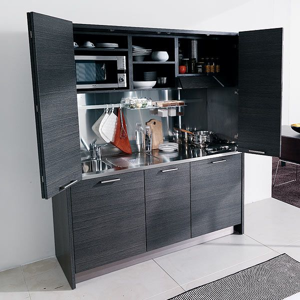 A stylish modern kitchen which can be hidden away behind bi-fold doors when not in use, so clever!