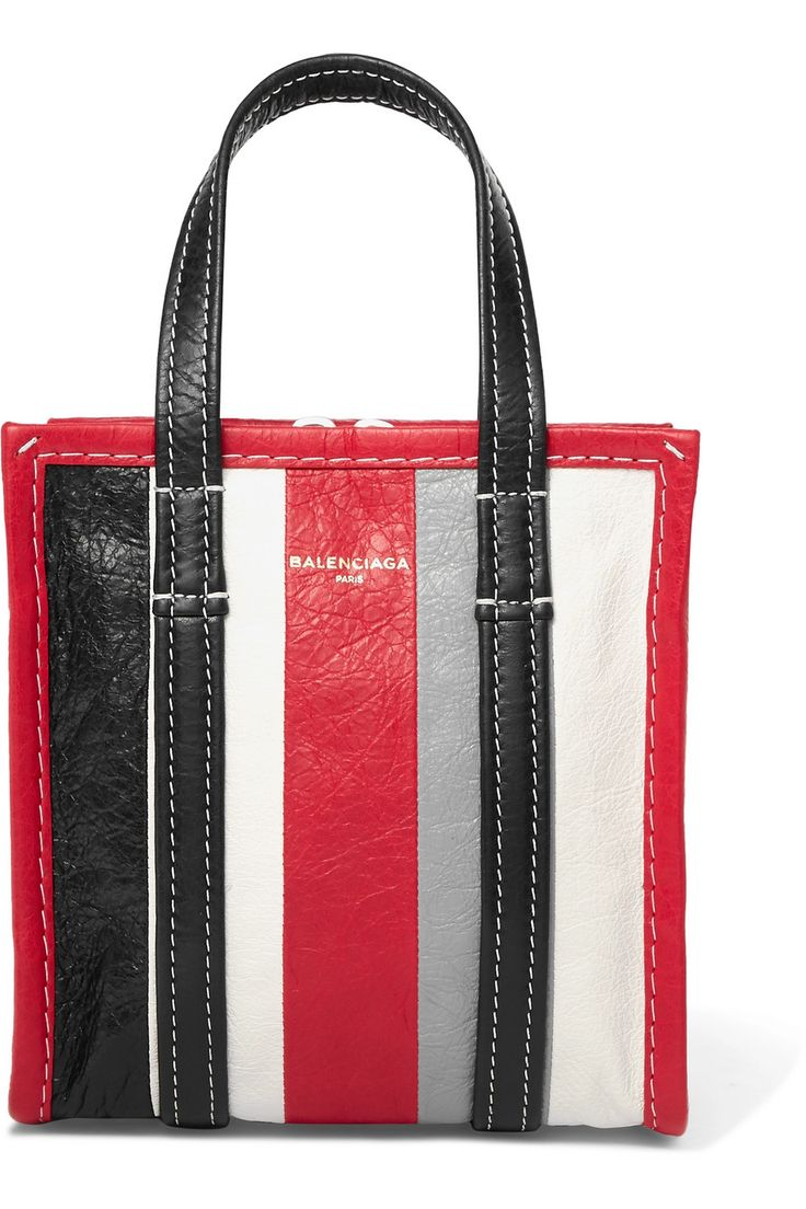 Originally inspired by plastic carrier bags used in Thai street markets, Balenciaga's striped 'Bazar' range is made from textured-leather. This cherry, gray, black and white 'XXS' version has the style's signature top handles, but is also equipped with a detachable cross-body strap so you can go hands-free. It's part of a collection Demna Gvasalia designed exclusively for us, so is sure to become a collector's piece.