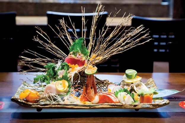 "Introducing: Kingyo Toronto Sashimi platter ($23-$45). The ""5 kind assortment"" ($30) features Hawaiian big eye tuna (maguro), Japanese yellowtail (hamachi), B.C. sweet shrimp (amaebi), wild sockeye salmon (sake) and scallop (hotategai), pictured here with a trio of East Coast oysters (market price)"