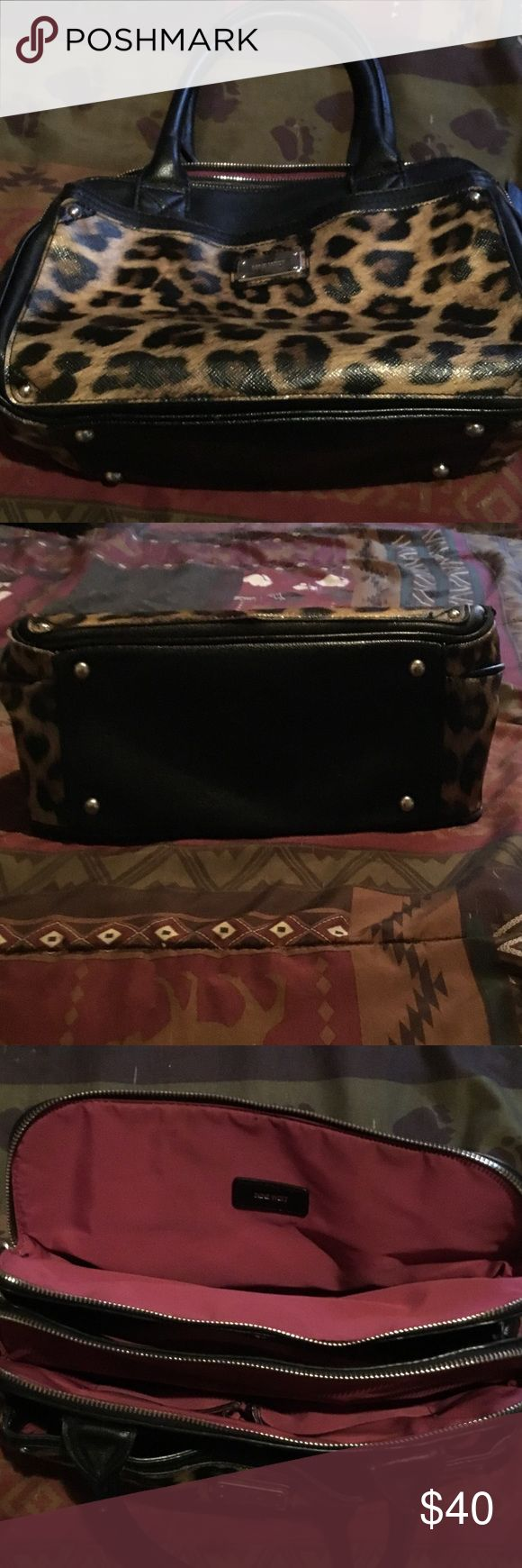 Leopard Nine West purse Leopard Nine West purse good condition has a very very little scar on scrap. Nine West Bags
