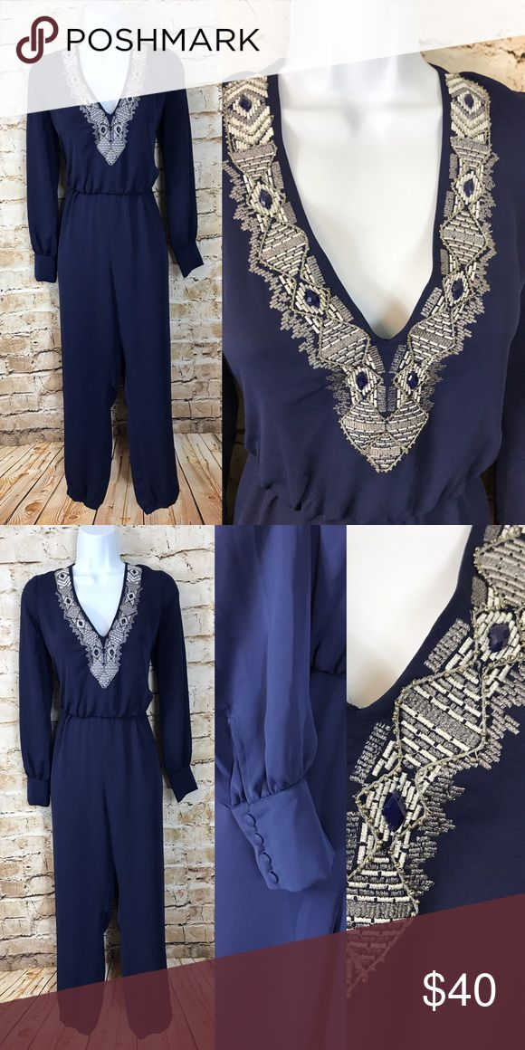 """BEBE Navy midnight and silver jumpsuit Material: polyester  Bust: 36-38"""" Waist:stretches 26-34 Hips:  34-40"""" Length: total length is 55"""" Inseam: 29"""" Details: Tagged size small. Fit is a bit oversized. Button cuffs. Elastic waist and elastic banded ankles. Embroidered and beaded/stones around collar. Midnight blue 👌🏽 bebe Pants Jumpsuits & Rompers"""