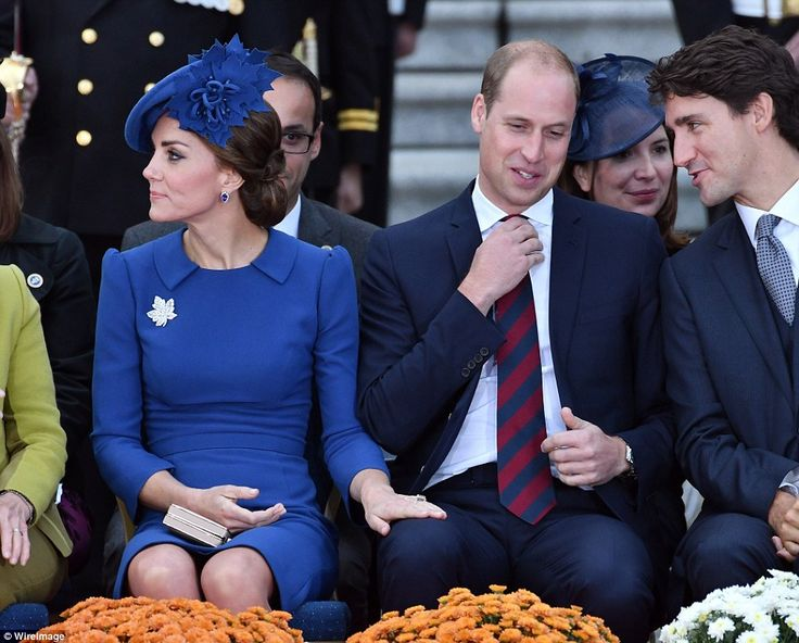 Kate laid a protective hand on William's thigh, as he exchanged pleasantries with Trudeau