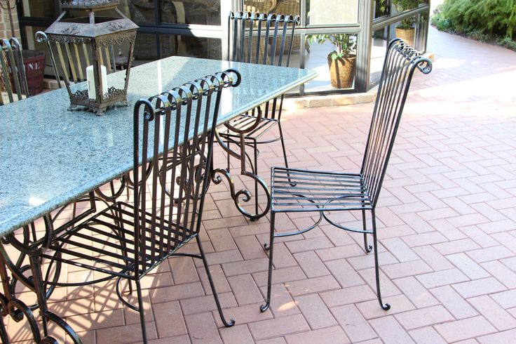 Granite table with wrought iron base & chairs.