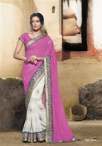 Royal feel...pretty pink pallu is on the white thread work embroidered saree!