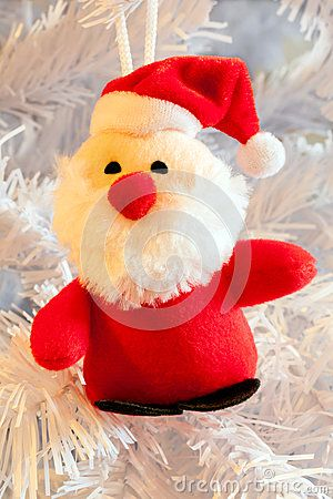 A close up of a cute little father Christmas decoration.
