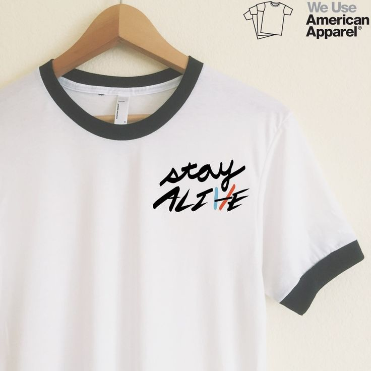Twenty One Pilots <3  We use authentic American Apparel ringer tees.  Our ringer tees are a staple to any girl's closet, adding a touch of  grunge. They look great styled casually with jeans and boots, or dressed up  with a cute plaid skirt.  Unlike other Poly-Cotton t-shirts on the market, ours is made with combed  cotton, giving it an ultra soft, worn in feel and superior drape.  AMERICAN APPAREL WHITE RINGER TEES  Poly-Cotton (50% Polyester / 50% Ring-Spun Combed Cotton) construction…