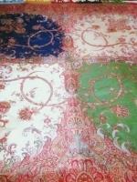 Vers 1830/1840  France  Lyon (?)    Etonnant châle cachemire français carré de l'époque Romantique.  Tissage au lancé découpé sur les premiers métiers Jacquart probablement d'une manufacture lyonnaise. Riche de sept couleurs, ce châle présente quatre quarts de couleur de différentes, crème, bleu, vert et blanc. Les dessinateurs de cette époque sous l'égide de l'école d'Amédée Coudert, combinent plusieurs styles, des fleurs des Indes stylisées au goût néo Rococo typique des années 1830