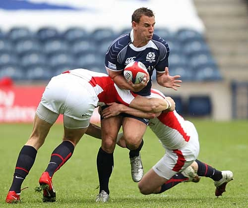 Scotland's Colin Shaw is tackled by England's James Rodwell and Rob Vickerman