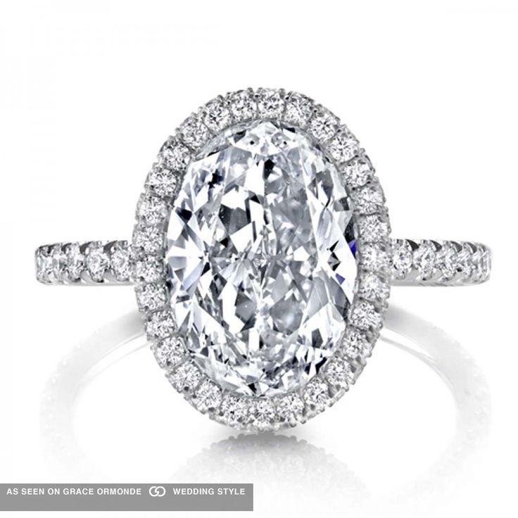 Jean Dousset oval-shaped diamond engagement ring. #jeandoussett #dousset #ovalshaped #weddingplanning #proposal #weddingideas #weddinginspiration #jewelry #bridal #bridaljewelry #diamond #engagementring #ring #engagement #luxuryweddings #graceormonde #weddingstyle