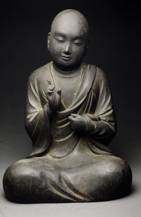 Figure of a Monk.  ARTIST:Artist Unknown.  DATE:T'ang dynasty  (618-907).    The Minneapolis Institute of Arts.