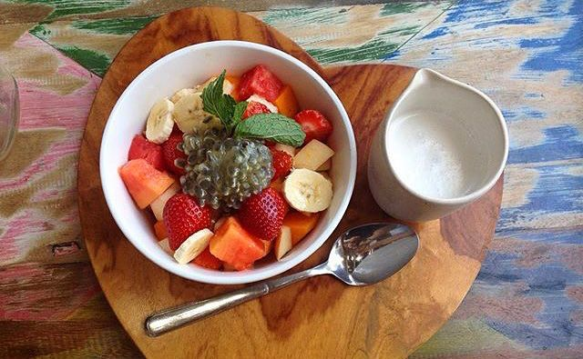 Fresh Fruit salad with choice of milk (soy, almond, cashew, coconut, cow) at Avocado Cafe Bali