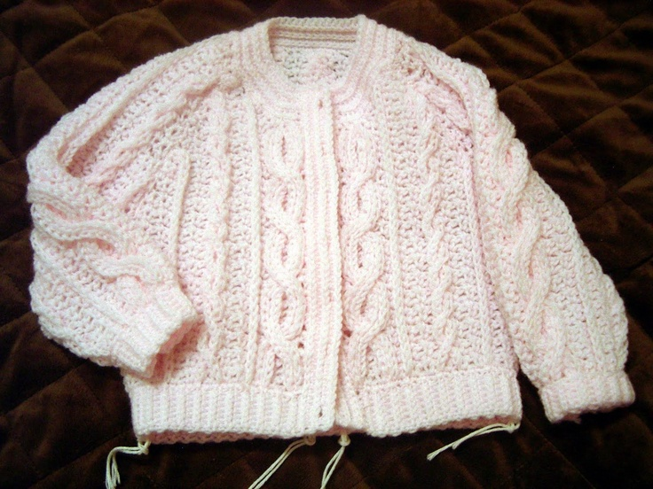 An Aran crochet baby sweater. Ingenious crochet pattern to look like knitting!