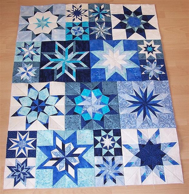 Winter Star Quilt.  I like the block setting and the colors. - This would be an easy setting for some pansy blocks I have.