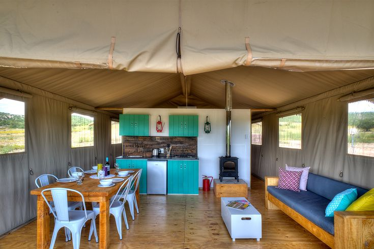 AfriCamps Glamping at Klein Karoo, South Africa. View of the inside. Kitchen area, dinning room and living room space.