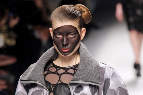 Korean designer Lie Sang Bong sent models in his fall 2012 show down the runway with large circular patches on their faces painted dark brown.