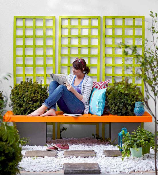 DIY garden bench is made from an old door and cinder blocks with the plants planted in the blocks and through the door. So cool!
