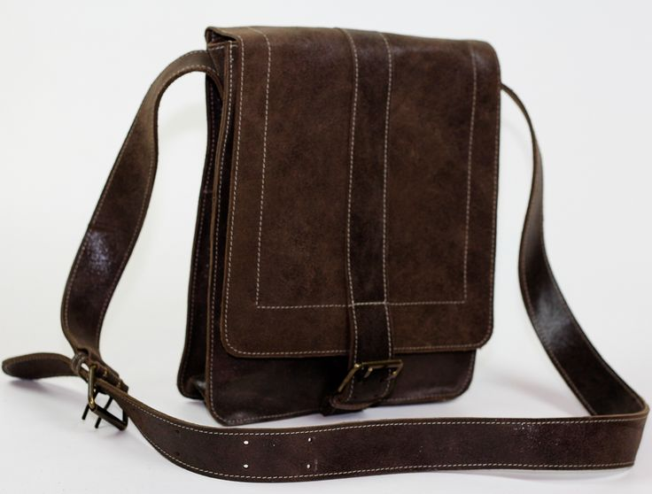 """PRODUCT INFO  This vintage style genuine leather bag features:      * Magnetic Closure     * 2 Outside zipper compartments and 1 outside pouch     * Dimensions Length 9.84"""" Width 3.15"""" Height: 11.87""""     * Handmade     * Long Adjustable Strap  Carry a tablet, cell phone, wallet, keys and other smaller items."""