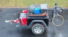 Expedition trailer with roof rack basket and front hitch basket