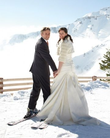 All-Star Wedding Ideas for the Ultimate Sports Fan - Pretty Photo-Op:   For couples getting hitched on or near the slopes, skis make a unique photo accessory. While you may not want to make a cool getaway in your wedding gown and tuxedo, you can easily pose for pics wearing a pair of ski boots and skis.  See More of This Real Wedding.