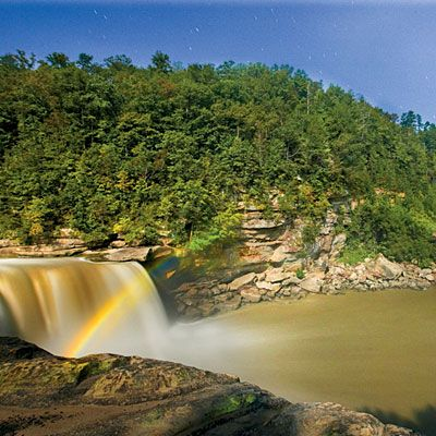 Moonbow, Kentucky | Visit Cumberland Falls State Resort Park during the five-day window surrounding a full moon. Naked eyes may see only a faint arc, but cameras can capture the full color spectrum. visitcumberlandfalls.com | SouthernLiving.com