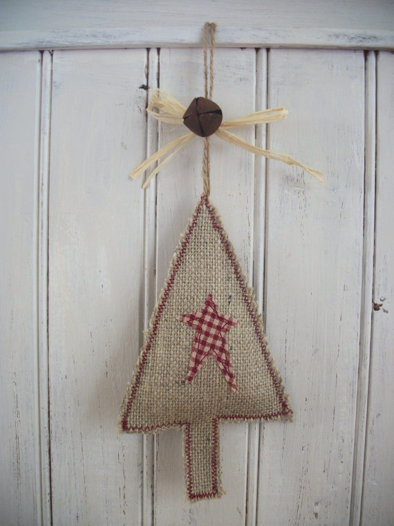 Decorated with a rusty bell, raffia bow and a twine loop for hanging.