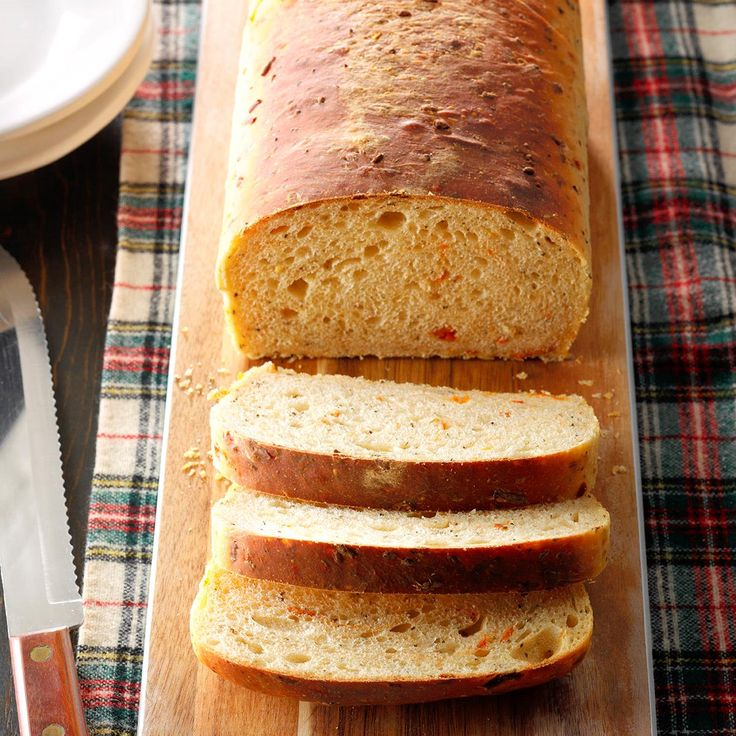 Basil Parmesan Bread Recipe -The combination of basil, Parmesan cheese and sun-dried tomatoes give this hearty bread a flavor that will take you right to Tuscany! —Sherry Hulsman, Elkton, Florida