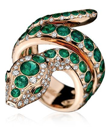 Divine Serpent Hypnotic Ring in 18k rose gold with diamonds and emeralds.
