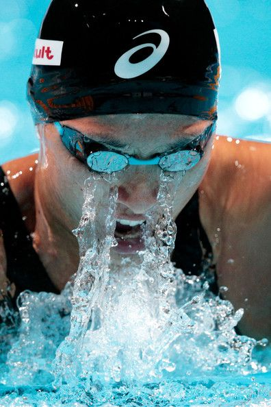 Satomi Suzuki of Team Japan competes during the Swimming Women's 4x100m Medley Relay preliminaries heat two on day sixteen of the 15th FINA World Championships at Palau Sant Jordi  on August 4, 2013 in Barcelona, Spain.