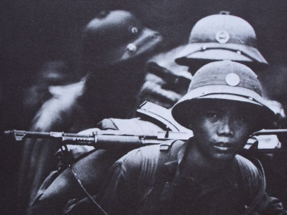 North Vietnamese Army soldiers wearing pith helmets during the war.