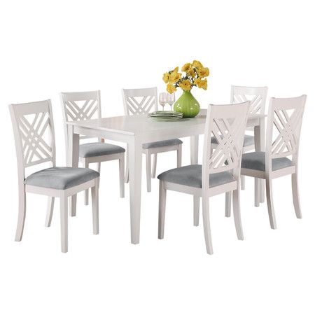 Perfect for weekend breakfasts and farm-fresh dinners, this classic dining table features a sleek silhouette and crisp white finish.