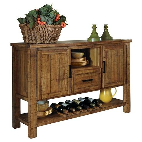 Cheers to the Krinden dining room server for nailing the stylish art of farmhouse-inspired design. Whether you're a major connoisseur or a fan of $5 varieties—proudly put it on display in a built-in wine rack that holds six bottles. Adjustable shelves behind the doors and a smooth-gliding drawer are perfect for tucking away everything from linens and cloth napkins, to cutlery and serving utensils.  Signature Design by Ashley is a registered trademark of Ashley Furniture In...