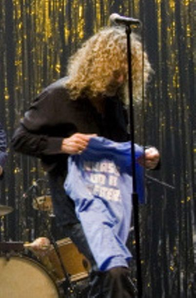 Robert Plant caught the shirt when the fan threw it and shouted out 'Nurses do it better!' Robert Plant laughed and said 'I know'
